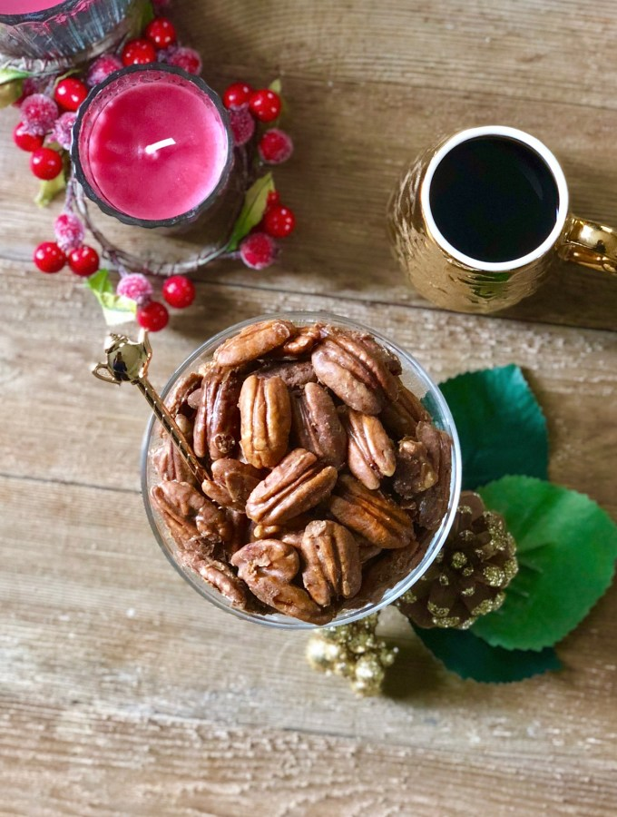 aerial view of caramel coffee pecans in a glass dish on table