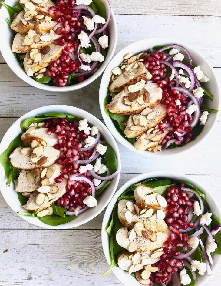 spinach pomegranate salads on a table