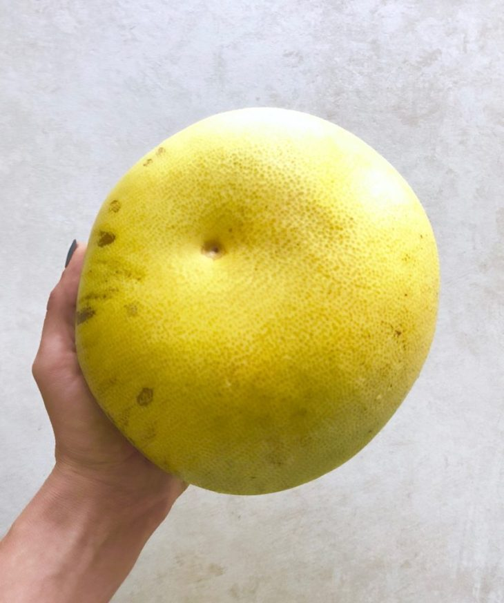 hand holding a pomelo