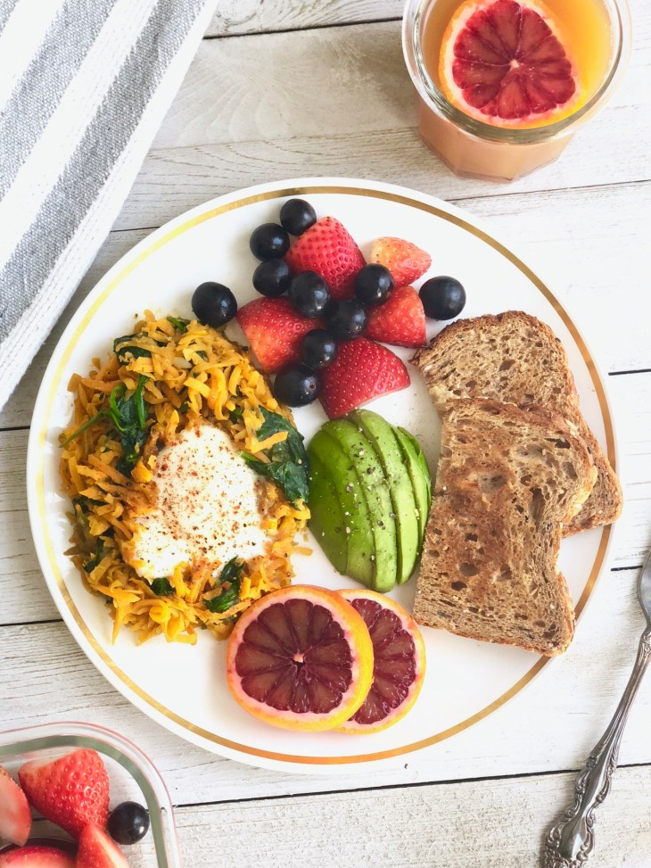 sweet potato hash with fruit and toast on a plate