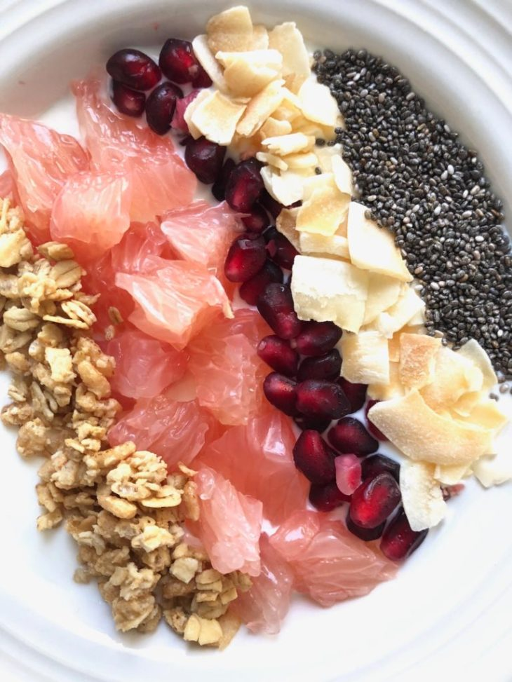 greek yogurt with winter fruit, granola, coconut and chia seed toppings