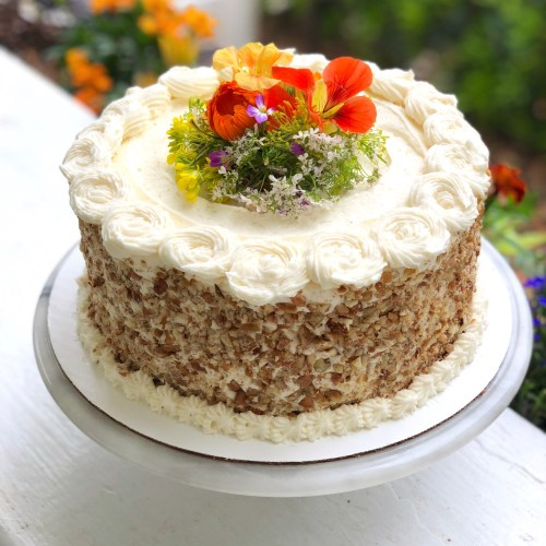carrot cake decorated with edible flowers