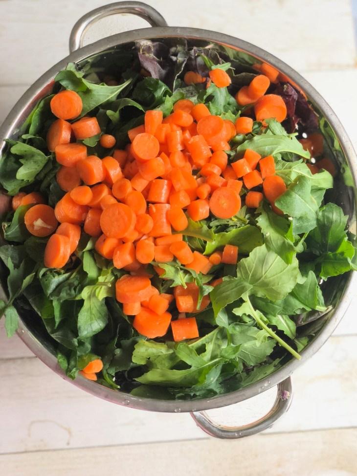 cut up veggies in a colandar
