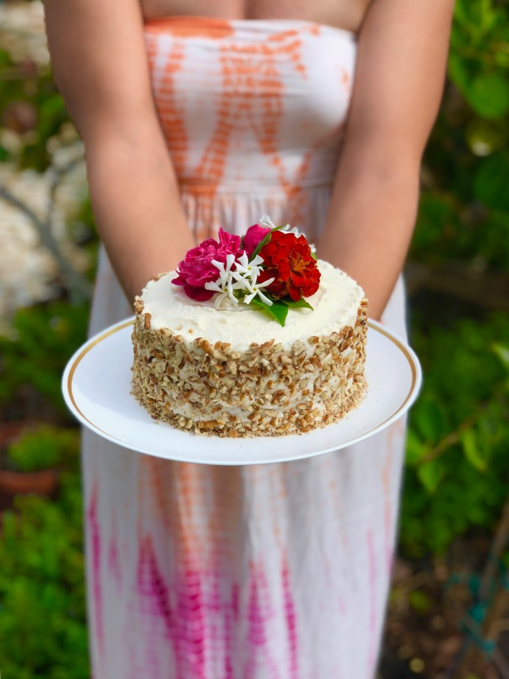 carrot cake with flowers from garden