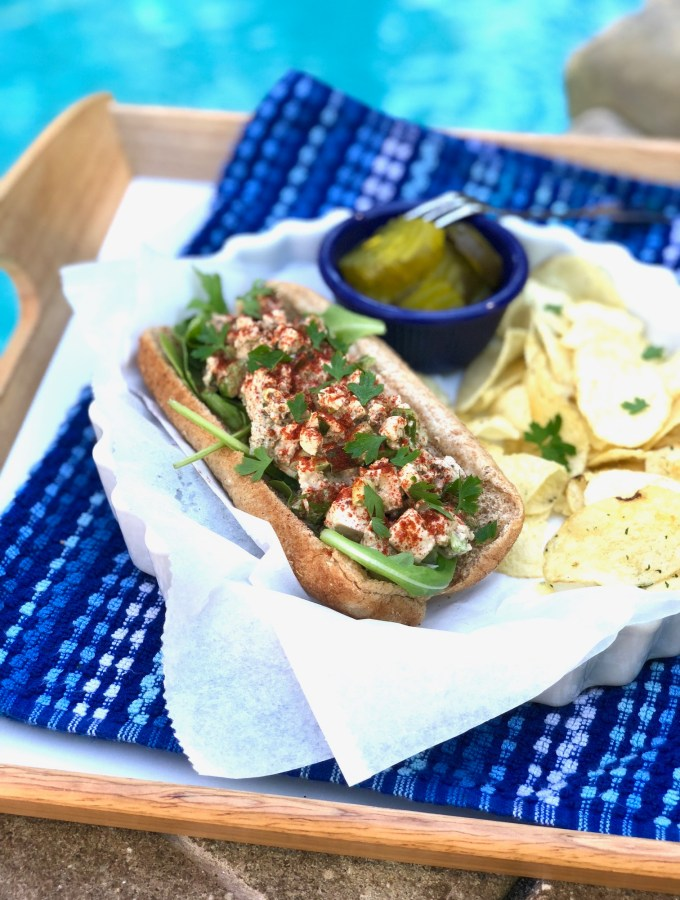 picture of vegan lobster roll by the pool