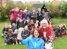 Head teacher Sue Stokoe and Lead Member Cllr Joan Atkinson celebrate the news with staff and children.