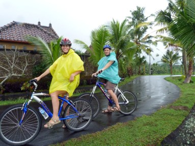 Clare and Rob's cyclie tour in the rain. Image from a holiday in Ubud, Bali, Indonesia. July 2012.