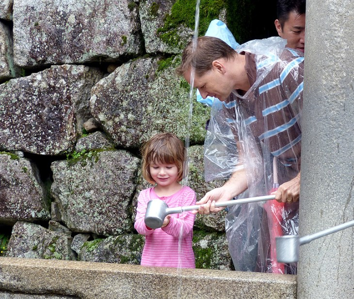 Drinking from the foundtain at Kiyomizu-dera Temple Kyoto Japan