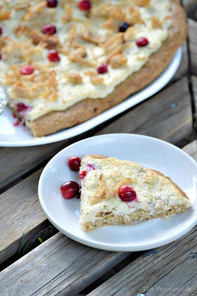 This white cream, turkey and cranberry pizza makes an amazing Thanksgiving leftover meal that everyone will love! | thanksgiving leftover recipes | thanksgiving leftovers | gluten-free thanksgiving leftovers | gluten-free pizza | thanksgiving leftover ideas || This Vivacious Life #thanksgivingleftovers #thanksgivingleftoverrecipes #glutenfreepizza