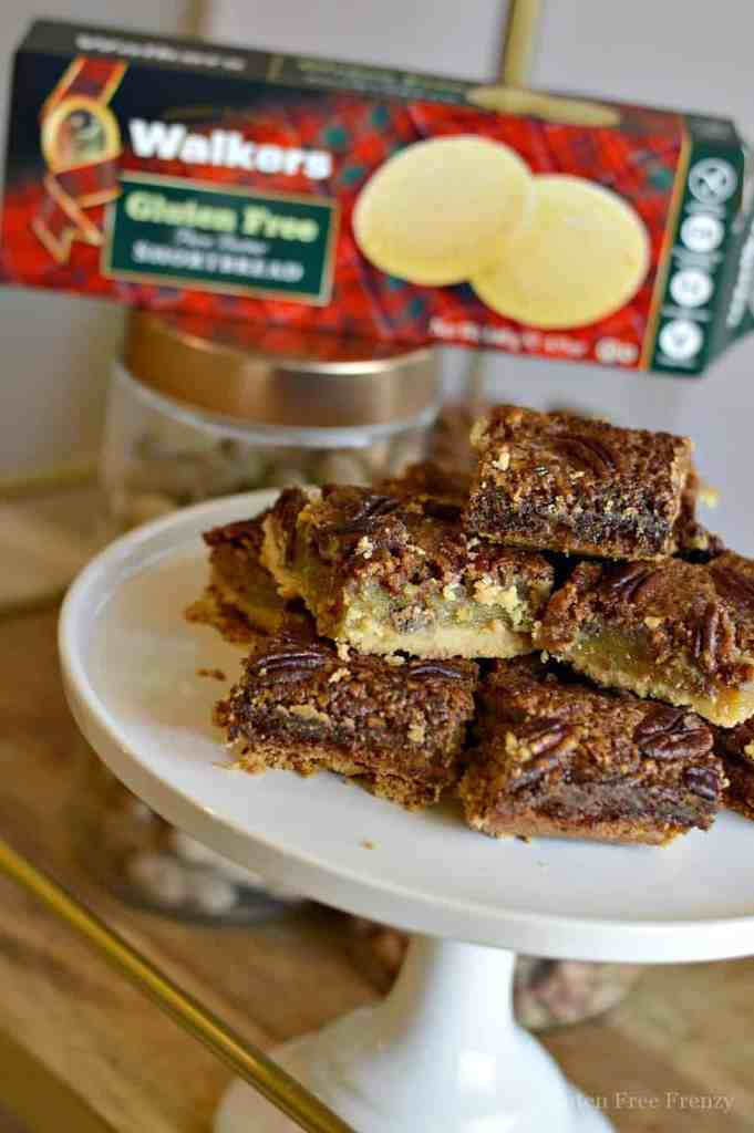 These gluten-free pecan pie shortbread bars are truly decadent in every way. They are rich and buttery. Nobody would ever know this fall dessert is gluten-free. | gluten-free thanksgiving recipes | gluten-free thanksgiving desserts | gluten-free pecan pie | gluten-free bar recipes | gluten-free desserts | gluten-free holiday recipes || This Vivacious Life #glutenfreethanksgiving #glutenfreepecanpie #glutenfreedesserts