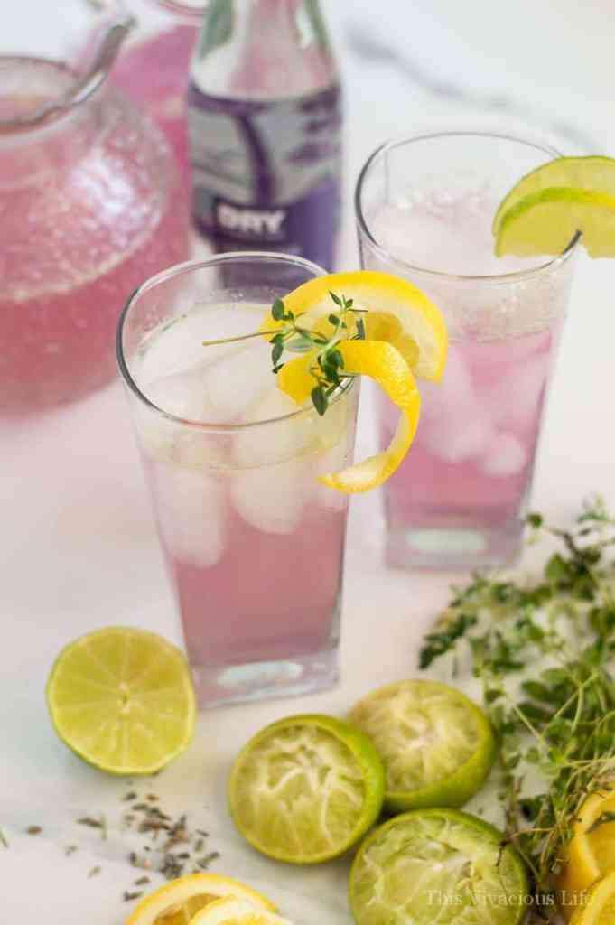 Glass filled with lavender lemonade and lemon zest