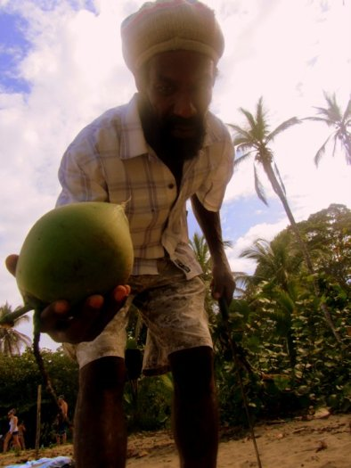 Rasta Man with a Coconut on Puerto Viejo Beach