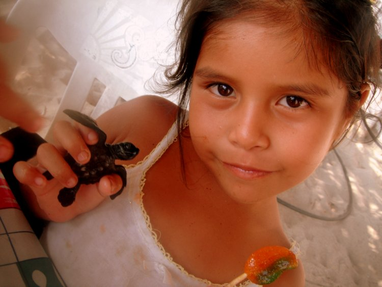 Zipolite girl with baby turtle