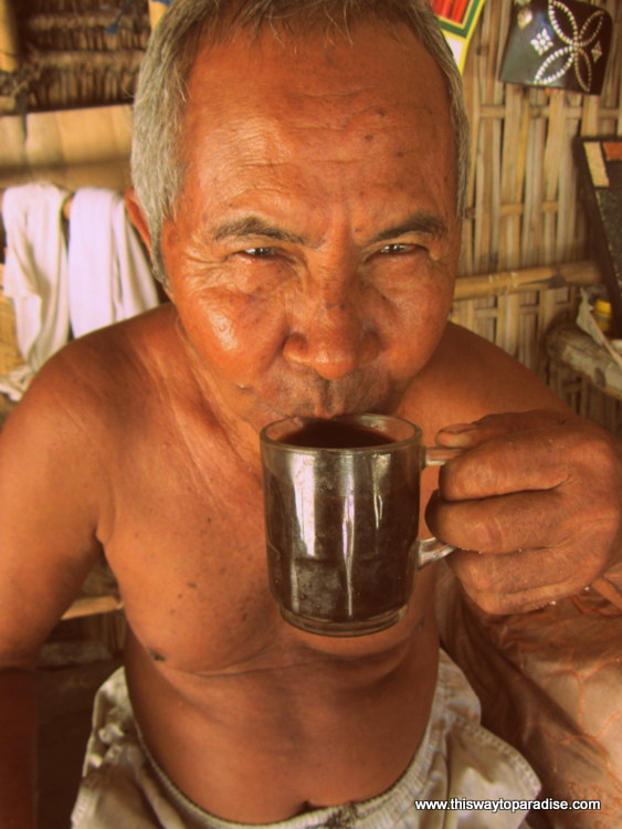 Man drinking coffee on Gili Meno, Gili Islands