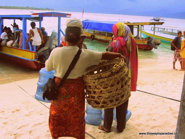Women getting on the ferry in Gili Meno, Gili Islands