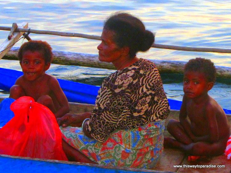Family on a small boat, Raja Ampat