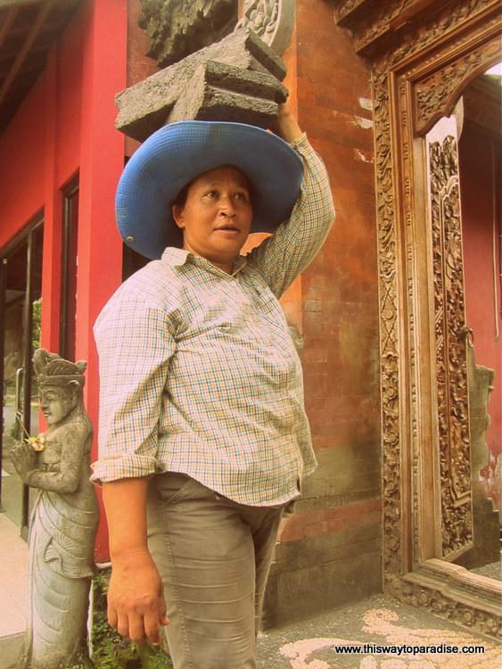 Bali woman with bricks on head