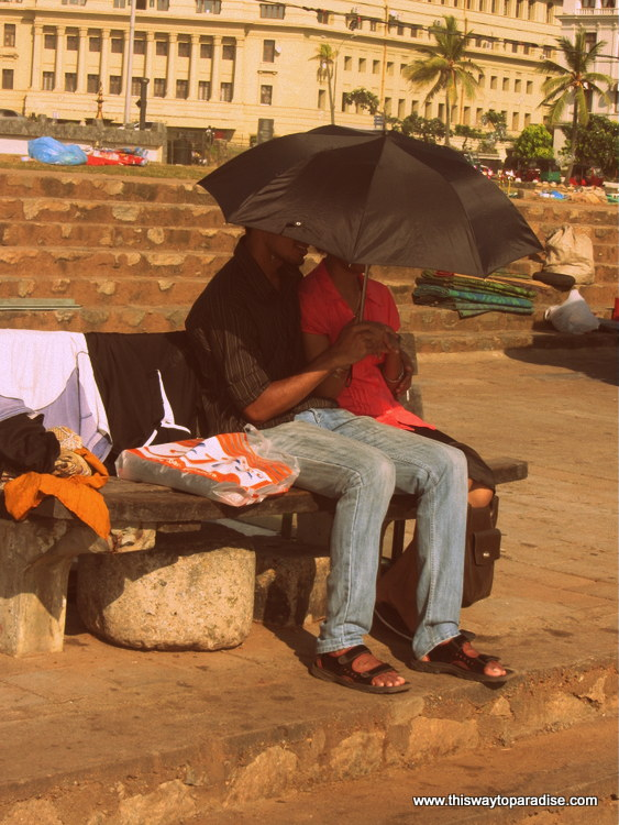 People staying out of the sun with umbrellas in Colombo, Sri Lanka