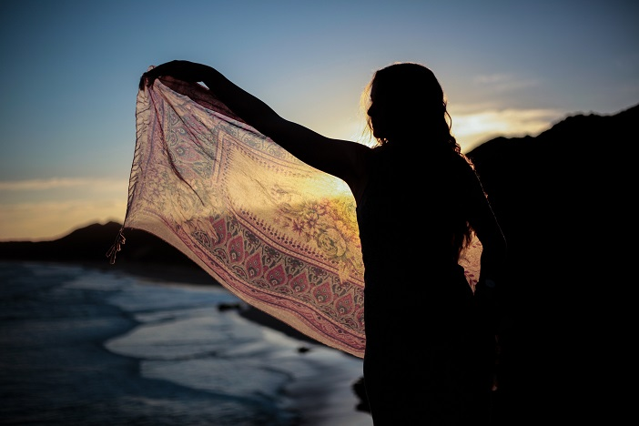 silhouette of girl with transparent scarf