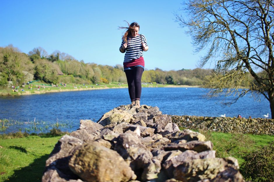 Walking on an old stone wall at Lough Gur, Ireland