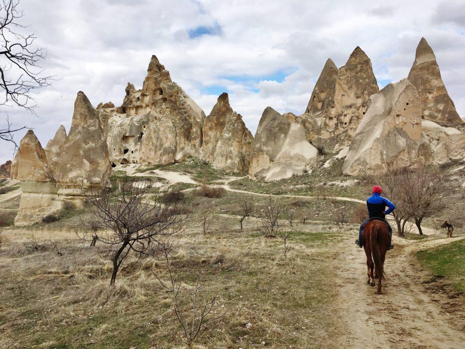 Riding on horseback through the landscape of Cappadocia, Turkey