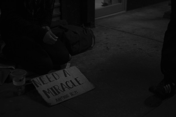 Homeless person with a sign