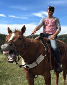 THN Team Member Kraig Blaize-Fiero, CoC Programs Coordinator, riding a horse