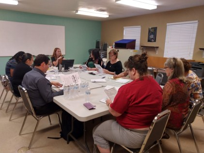 A group of community members in Williamson County meeting with THN staff, Kyra Henderson.