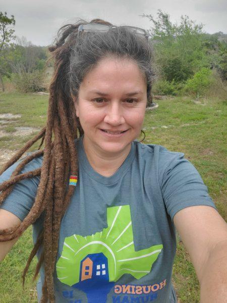 Deanne Locke taking a selfie in a Homelessness Awareness Day dark grey tshirt