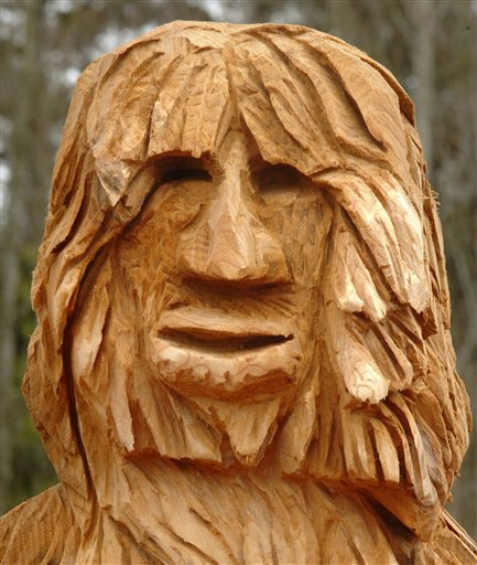 "The chainsaw-carved ""Bigfoot,"" by George Kenny, is seen on Sunday March 30, 2008 in Federal Way, Wash. The winning carving, to replace the carving that was stolen from outside Tom Payne's chiropractic clinic, was made by Charlie Hubbard, 58, of Gig Harbor, whose 9-foot work was taller than the pieces made by Kenny of Allyn, Wash. and Mark Herrington (54) from Wilkeson, Wash. (AP Photo/The News Tribune, Russ Carmack)"