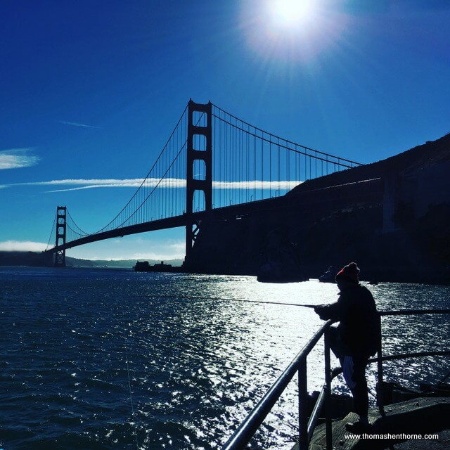 Photo of Fisherman and Golden Gate Bridge in background
