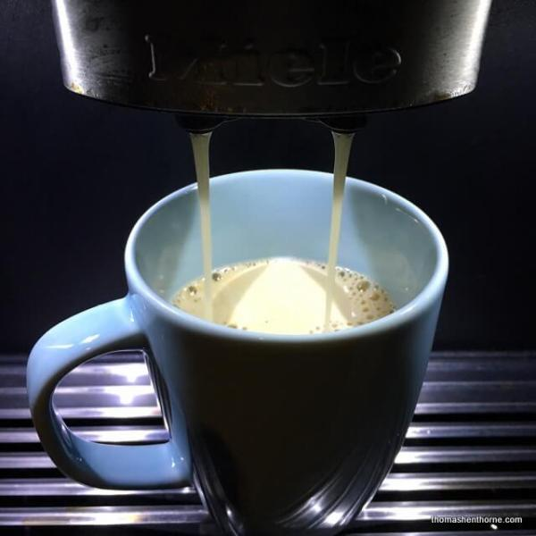 luxury real estate cup of coffee on miele coffee maker