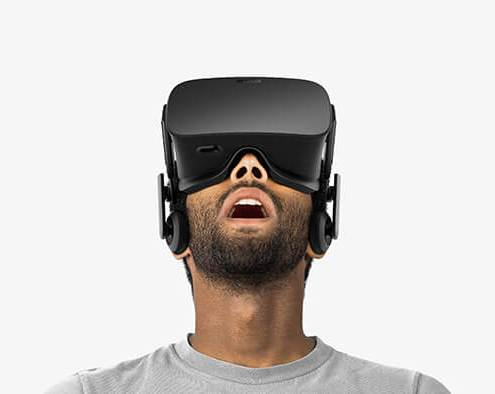photo of man wearing oculus rift virtual reality headset