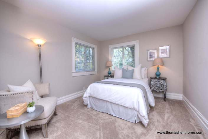 photo of bedroom with two lamps and nightstands