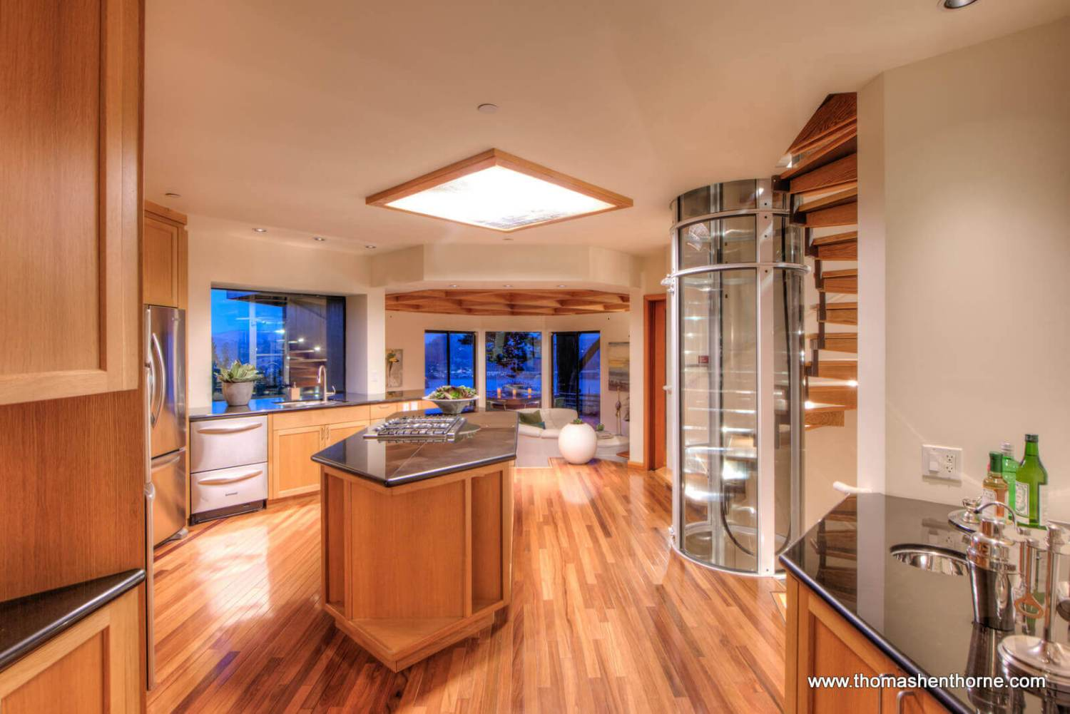 Kitchen view with center island and elevator