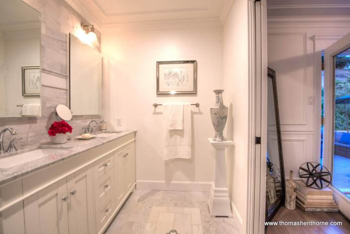Master Bath with vase on pedestal