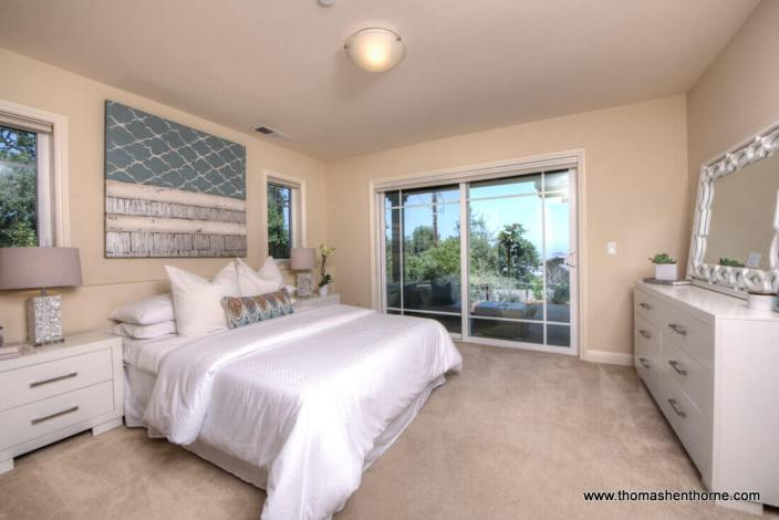 Photo of Bed and sliding door out onto deck