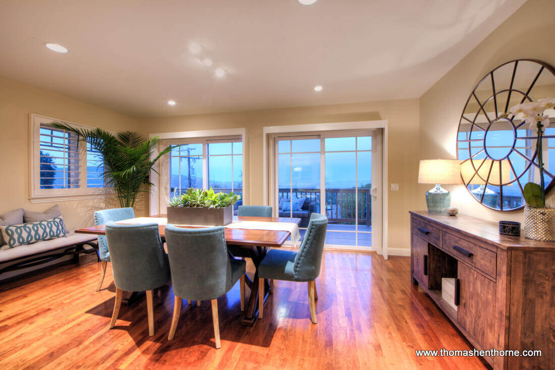 Dining Area with deck and view of bay beyond
