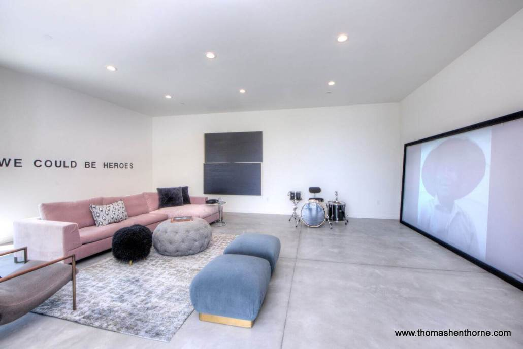 """media room with """"we could be heroes"""" on the wall"""