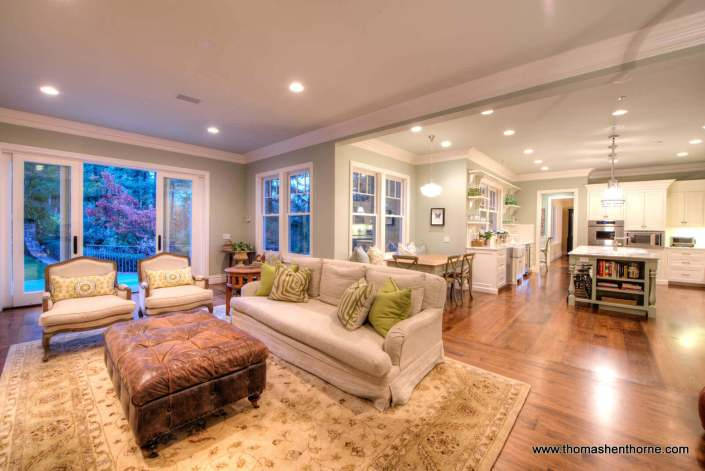 Family room with kitchen in distance open floor plan