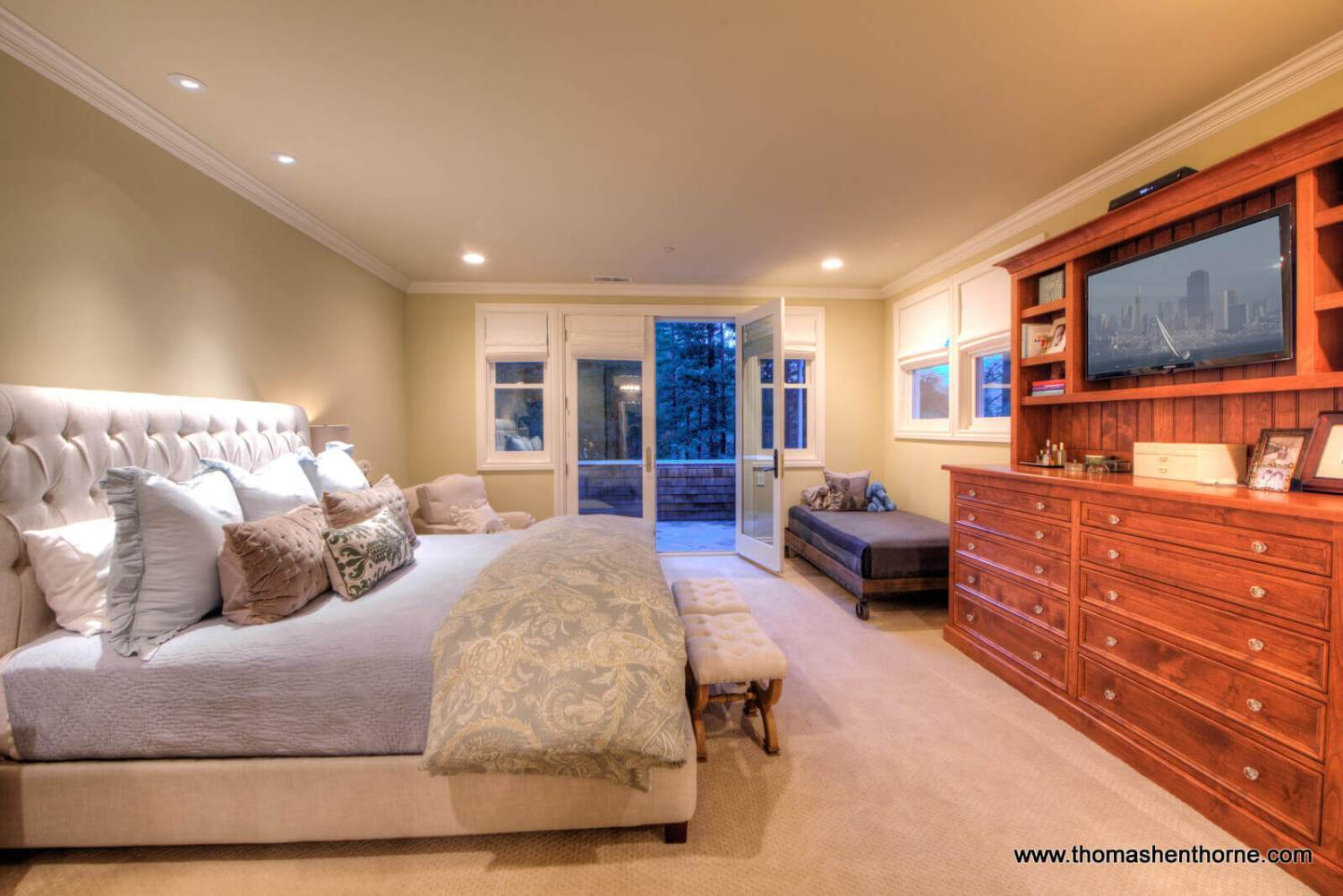 Master bedroom with french doors opening onto deck