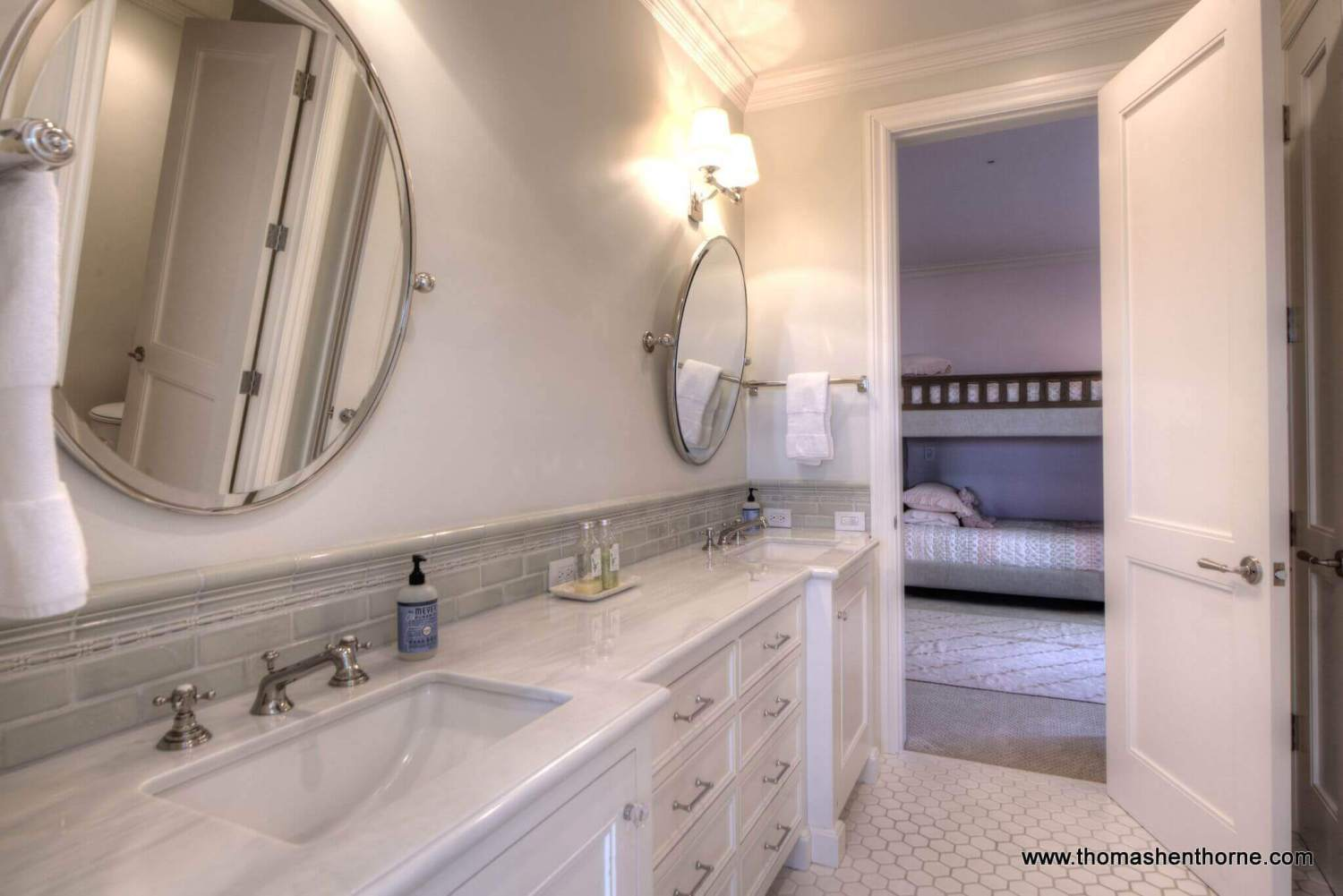 bathroom with double sinks and marble countertops