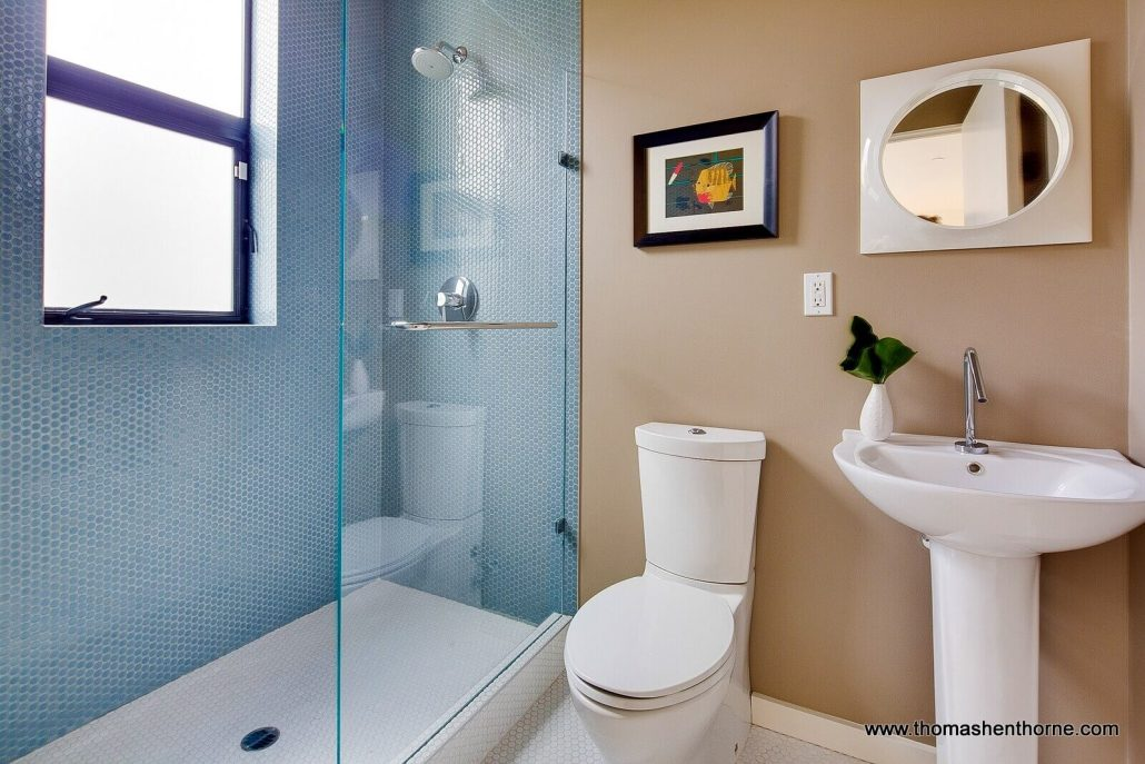 Bathroom with pedestal sink and mosaic tile