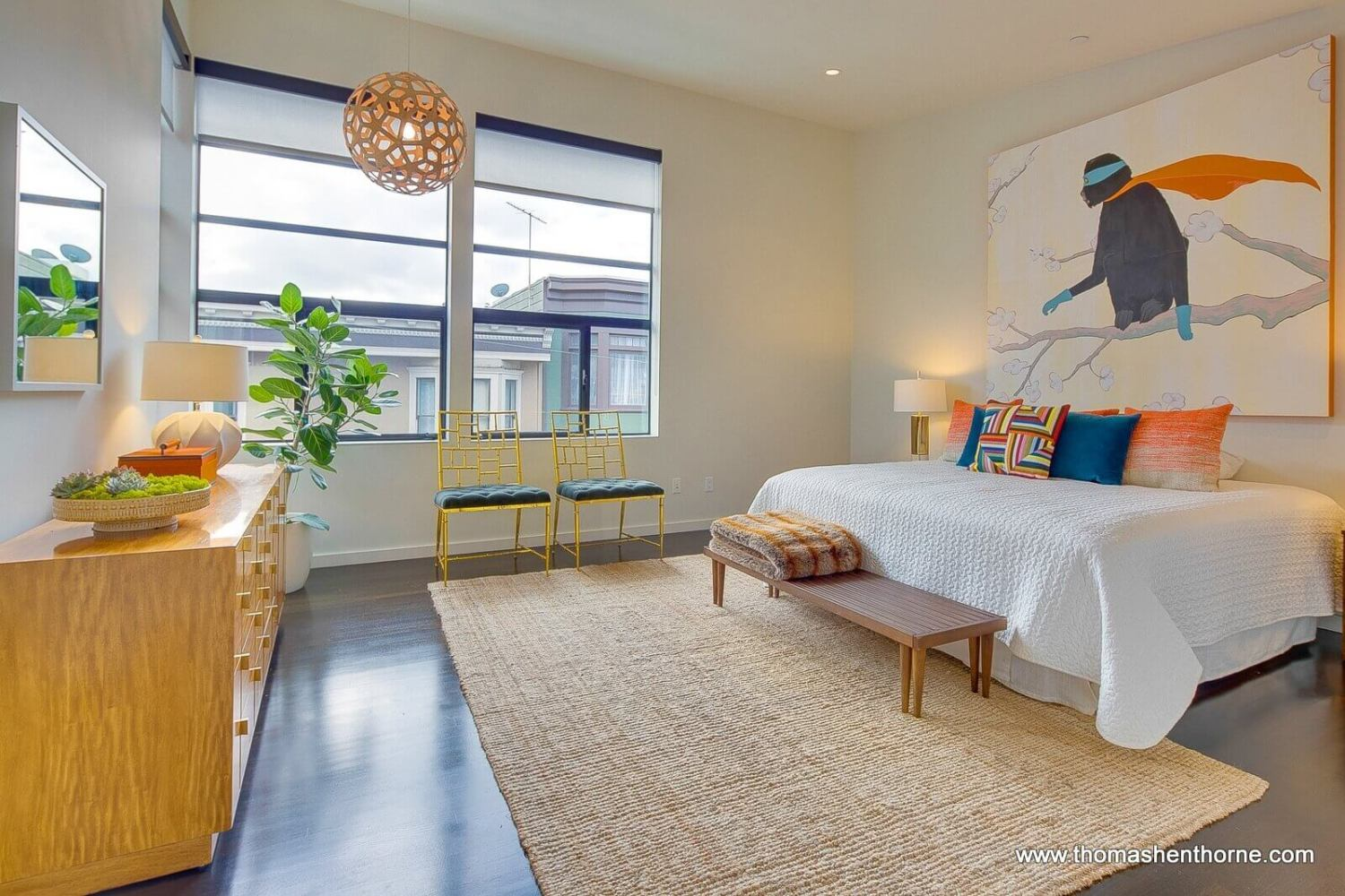 Bedroom with windows looking out onto street