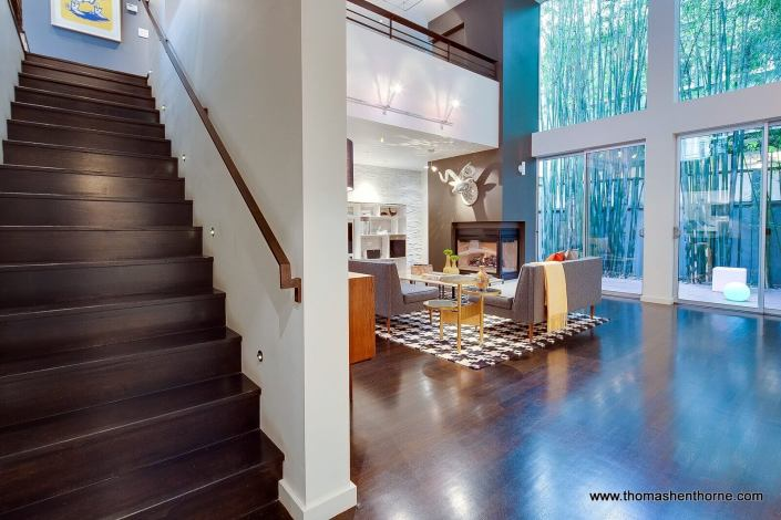 Entering living room with view of timber bamboo and wall of glass