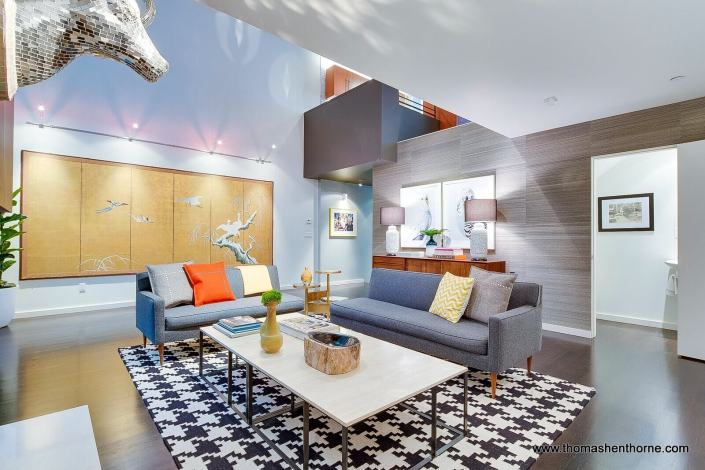 Living room angle three showing wall mural and bold carpet