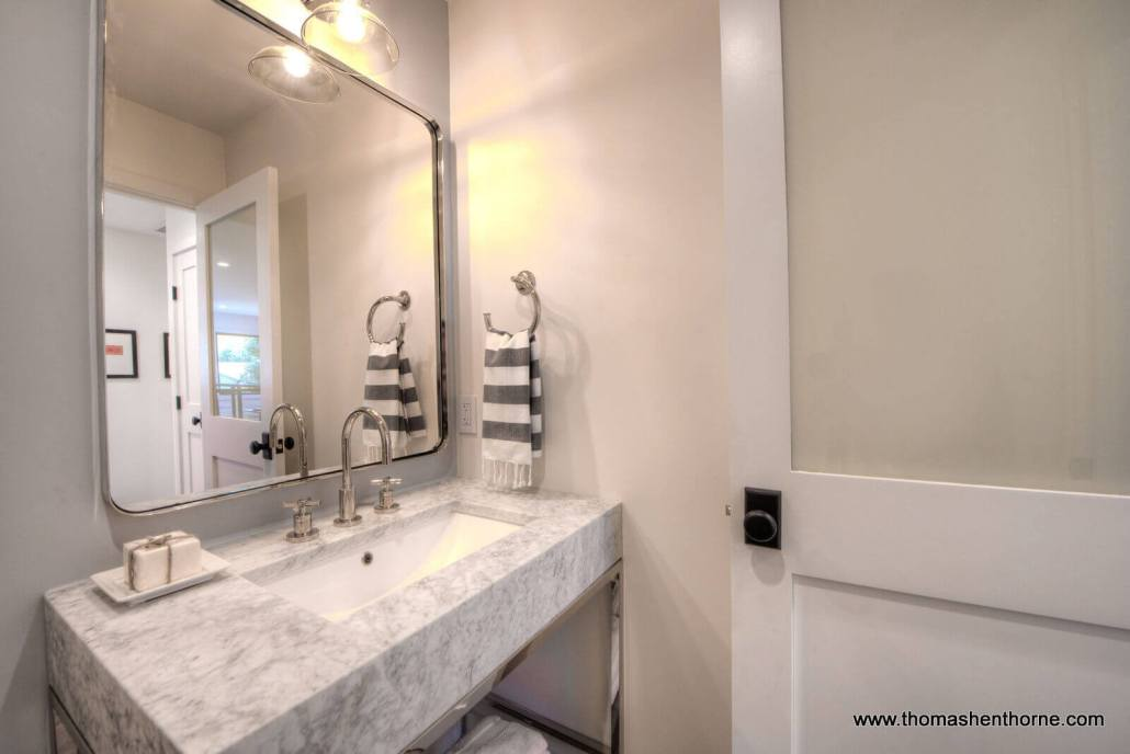 photo of marble vanity and mirror in half bath