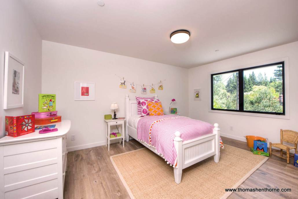 Second bedroom with twin bed and view to the street