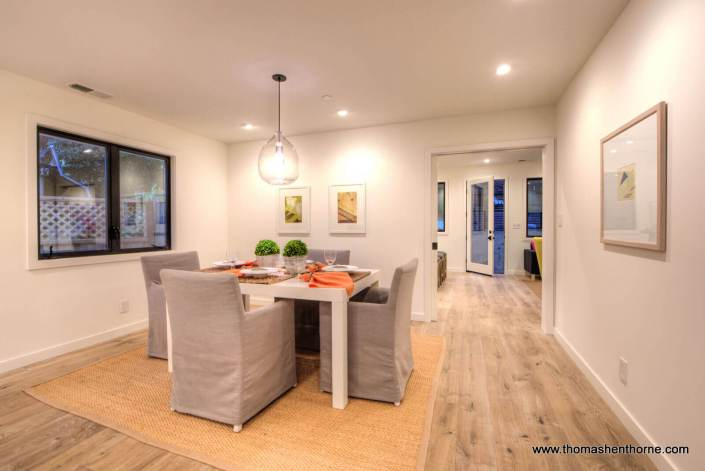 Dining table with door to kitchen / family room beyond