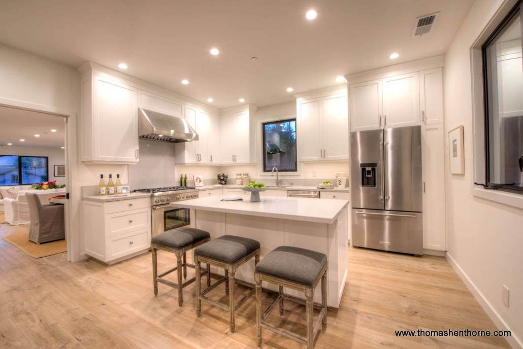 Kitchen with island and stainless appliances at 304 Bolinas Ave.